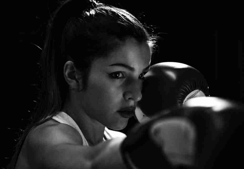 Woman punching with boxing gloves